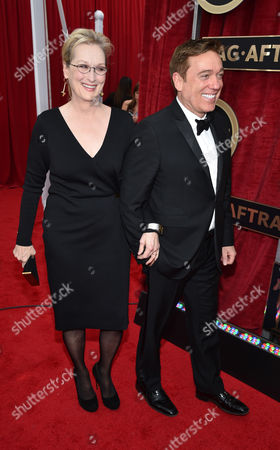 Meryl Streep, left, and Kevin Huvane arrive at the 21st annual Screen Actors Guild Awards at the Shrine Auditorium, in Los Angeles