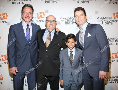 From left, Tim DeKay, Willie Garson, Nathen Garson, and Matt Bomer arrive at the 22nd Annual Alliance for Children's Rights Dinner at The Beverly Hilton Hotel on in Beverly Hills, Calif