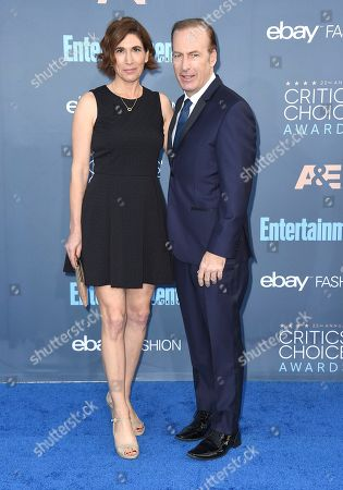Bob Odenkirk, right, and Naomi Odenkirk arrive at the 22nd annual Critics' Choice Awards at the Barker Hangar, in Santa Monica, Calif