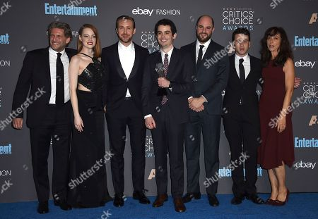 """Gary Gilbert, from left, Emma Stone, Ryan Gosling, Damien Chazelle, Jordan Horowitz, Justin Hurwitz, and Mary Zophres pose in the press room with the award for best picture for """"La La Land"""" at the 22nd annual Critics' Choice Awards at the Barker Hangar, in Santa Monica, Calif"""