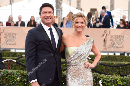 Louis Aguirre, left, and Debbie Matenopoulos arrive at the 22nd annual Screen Actors Guild Awards at the Shrine Auditorium & Expo Hall, in Los Angeles