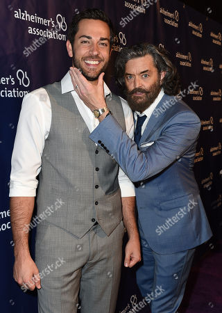"Zachary Levi, left, and Timothy Omundson arrive at the 23rd annual ""A Night at Sardi's"" to benefit the Alzheimer's Association at the Beverly Hilton Hotel, in Beverly Hills, Calif"
