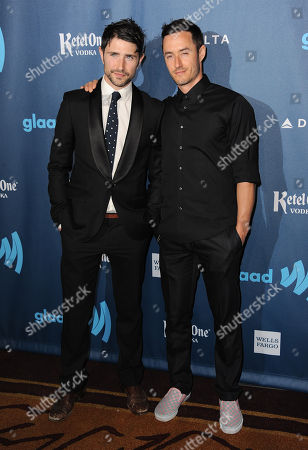 Matt Dallas, left, arrives at the 24th Annual GLAAD Media Awards at the JW Marriott on in Los Angeles