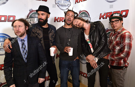 Mike Einziger, from left, Ben Kenney, Chris Kilmore, Brandon Boyd and Jose Pasillas, of Incubus, pose in the press room at the 25th annual KROQ Almost Acoustic Christmas at The Forum, in Inglewood, Calif