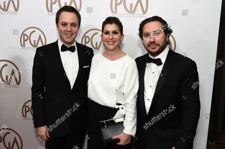 Ido Ostrowsky, from left, Nora Grossman, and Teddy Schwarzman arrive at the 26th Annual Producers Guild Awards at the Hyatt Regency Century Plaza, in Los Angeles