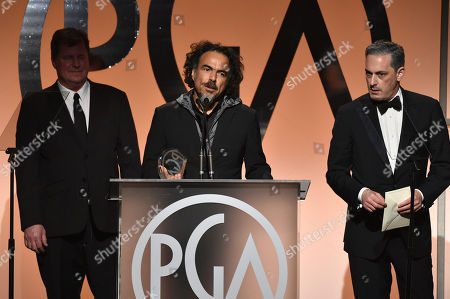 James W. Skotchdopole, and from left, Alejandro Gonzalez Inarritu, and John Lesher accept the Darryl F. Zanuck Award for outstanding producer of theatrical motion pictures for â?œBirdmanâ??on stage at the 26th Annual Producers Guild Awards at the Hyatt Regency Century Plaza, in Los Angeles