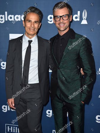 Stock Photo of Gary Janetti, left, and Brad Goreski arrive at the 27th Annual GLAAD Media Awards at the Beverly Hilton, in Beverly Hills, Calif