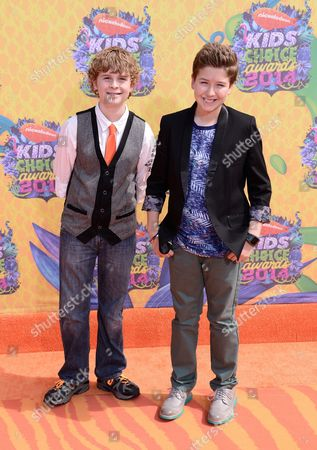 Adam Hochstetter, left, and Garrett Ryan arrive at the 27th annual Kids' Choice Awards at the Galen Center, in Los Angeles