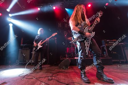 Stock Image of Bassist Geezer Butler, drummer Tommy Clufetos, and guitarist Zakk Wylde perform on stage at the 2nd Annual Heroes Helping Heroes Benefit Concert at The House of Blues on in Los Angeles