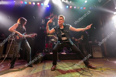 Singer Mark McGrath and bassist Rudy Sarzo perform on stage at the 2nd Annual Heroes Helping Heroes Benefit Concert at The House of Blues on in Los Angeles