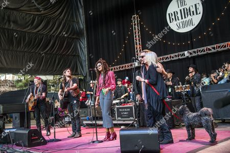 Willie Nelson, from left, Jim James, and Pegi Young perform at the 30th Annual Bridge School Benefit Concert at the Shoreline Amphitheater, in Mountain View, Calif