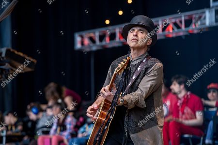 Stock Picture of Nils Lofgren performs at the 30th Annual Bridge School Benefit Concert at the Shoreline Ampthitheatre, in Mountain View, Calif