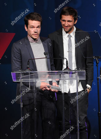 Nate Ruess, left, and Andrew Dost of the musical group Fun accept the Vanguard Award at the 31st Annual ASCAP Pop Music Awards at the Loews Hollywood Hotel, in Los Angeles
