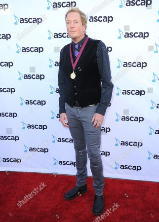 Dave Bassett, award winner for Fight Song, Ex's And Oh's and top song performance award winner for Ex's & Oh's, arrives at the 33rd annual ASCAP Pop Music Awards at the Dolby Ballroom, in Los Angeles