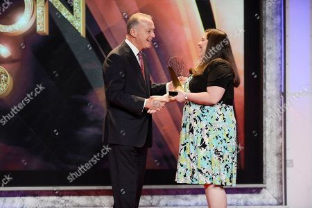 Stock Picture of Kimberly Snyder(R) of Carlow University accepts the Mister Rogers Scholarship, New Media-Grable Foundation, from Bill Isler of The Fred Rogers Company onstage at the 34th College Television Awards presented by the Academy of Television Arts & Sciences Foundation at the JW Marriott Los Angeles L.A. Live on in Los Angeles, California