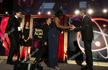"""Nick Wechsler presents Nickesha Johnson, Anthony Tart, and Michael Gomez of Brooklyn College with the award in the Newscast category for """"Brooklyn College News Show 1"""" at the 35th College Television Awards, presented by the Television Academy Foundation at The Leonard H. Goldenson Theatre in the NoHo Arts District, in Los Angeles"""