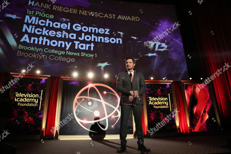 Nick Wechsler presents a College Television Award at the 35th College Television Awards, presented by the Television Academy Foundation at The Leonard H. Goldenson Theatre in the NoHo Arts District, in Los Angeles