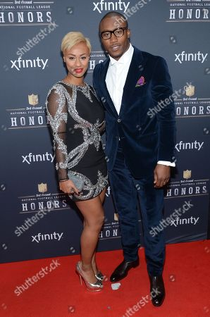 Stock Photo of Michi Nogami, left, and Brandon Marshall of the Chicago Bears arrive at the 3rd annual NFL Honors at Radio City Music Hall, in New York