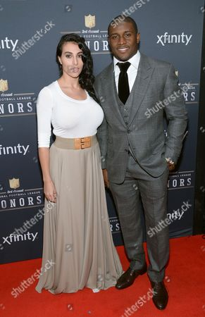 Reggie Bush of the Detroit Lions, right, and Lilit Avagyan arrive at the 3rd annual NFL Honors at Radio City Music Hall, in New York
