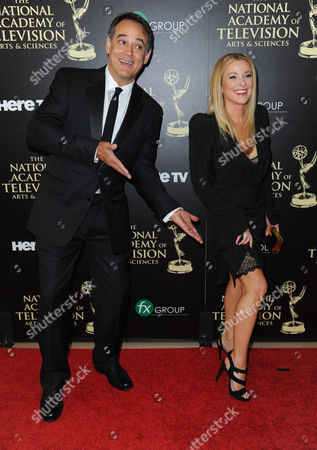 Jon Lindstrom, left, and Cady McClain arrive at the 41st annual Daytime Emmy Awards at the Beverly Hilton Hotel, in Beverly Hills, Calif