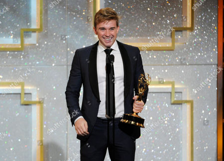 Chandler Massey accepts the award for outstanding younger actor in a drama series for Days of our Lives at the 41st annual Daytime Emmy Awards at the Beverly Hilton Hotel, in Beverly Hills, Calif