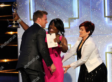 Sharon Osbourne, from right, Sheryl Underwood present the award for outstanding lead actor in a drama series to Billy Miller for The Young and the Restless at the 41st annual Daytime Emmy Awards at the Beverly Hilton Hotel, in Beverly Hills, Calif