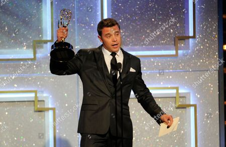 Billy Miller accepts the award for outstanding lead actor in a drama series for The Young and the Restless at the 41st annual Daytime Emmy Awards at the Beverly Hilton Hotel, in Beverly Hills, Calif
