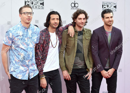Alex Tanas, from left, Nasri, Ben Spivak and Mark Pellizzer of the musical group Magic! arrive at the 42nd annual American Music Awards at Nokia Theatre L.A. Live, in Los Angeles