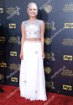 Kelli Goss arrives at the 42nd annual Daytime Emmy Awards at Warner Bros. Studios, in Burbank, Calif