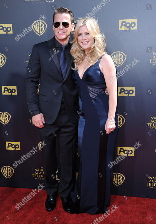 David Sanov, left, and Allison Sweeney arrive at the 42nd annual Daytime Emmy Awards at Warner Bros. Studios, in Burbank, Calif