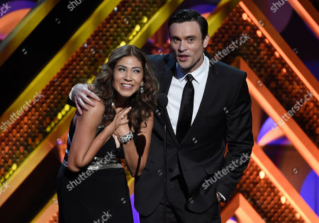 Sharon Hofreiter, left, and Daniel Goddard present the award for outstanding supporting actor in a drama series at the 42nd annual Daytime Emmy Awards at Warner Bros. Studios, in Burbank, Calif