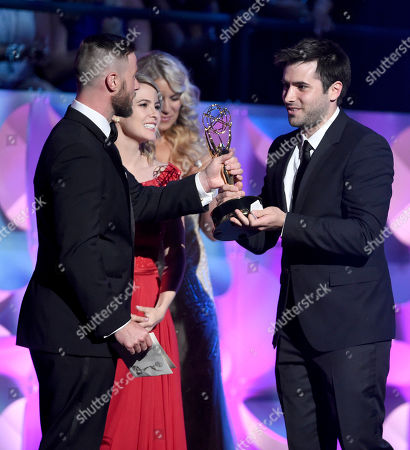 Jacob Young, from left, and Linsey Godfrey present the award for outstanding younger actor in a drama series to Freddie Smith at the 42nd annual Daytime Emmy Awards at Warner Bros. Studios, in Burbank, Calif