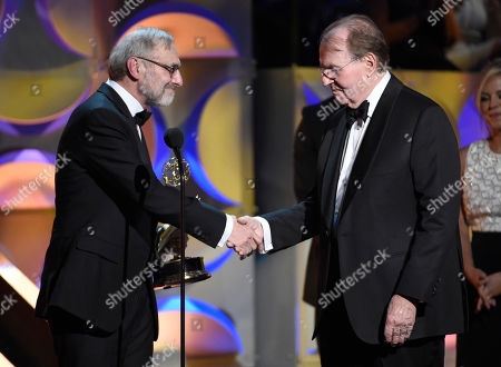 Rand Morrison, left, and Charles Osgood accept the award for outstanding morning program for â?oeCBS Sunday Morningâ?? at the 42nd annual Daytime Emmy Awards at Warner Bros. Studios, in Burbank, Calif