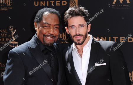 James Reynolds, left, and Brandon Beemer arrive at the 43rd annual Daytime Emmy Awards at the Westin Bonaventure Hotel, in Los Angeles