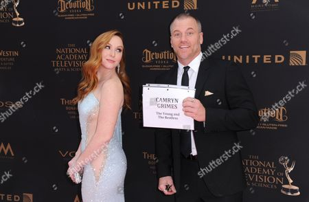 Camryn Grimes, left, and Sean Carrigan arrive at the 43rd annual Daytime Emmy Awards at the Westin Bonaventure Hotel, in Los Angeles