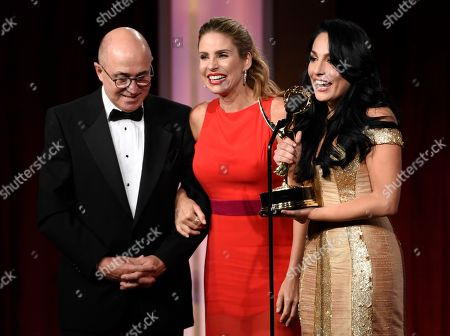 Eduardo Suarez, from left, Maria Alejandra Requena, and Alejandra Gutierrez Oraa accept the award for outstanding morning show in Spanish for Cafe CNN at the 43rd annual Daytime Emmy Awards at the Westin Bonaventure Hotel, in Los Angeles
