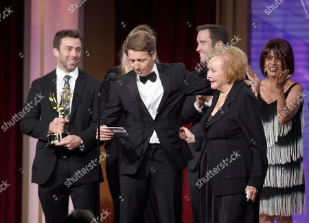 Bradley Bell, center, and the crew of The Bold and the Beautiful accept the award for outstanding writing in a drama series for The Bold and the Beautiful at the 43rd annual Daytime Emmy Awards at the Westin Bonaventure Hotel, in Los Angeles