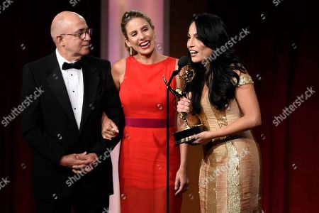 Eduardo Suarez, from left, Maria Alejandra Requena, and Alejandra Oraa accept the award for outstanding morning show in Spanish for Cafe CNN at the 43rd annual Daytime Emmy Awards at the Westin Bonaventure Hotel, in Los Angeles