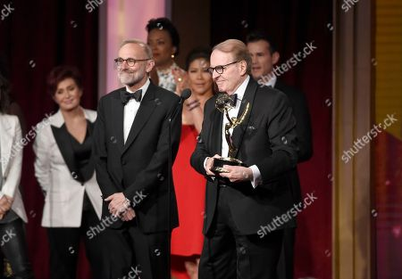 Rand Morrison, left, and Charles Osgood accept the award for outstanding morning program for CBS Sunday Morning at the 43rd annual Daytime Emmy Awards at the Westin Bonaventure Hotel, in Los Angeles