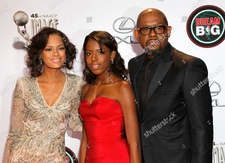 From left, Keisha Whitaker, Sonnet Whitaker, and Forest Whitaker arrive at the 45th NAACP Image Awards at the Pasadena Civic Auditorium, in Pasadena, Calif