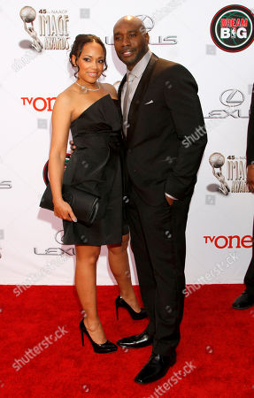 Stock Picture of Pam Byse, left, and Morris Chestnut arrive at the 45th NAACP Image Awards at the Pasadena Civic Auditorium, in Pasadena, Calif
