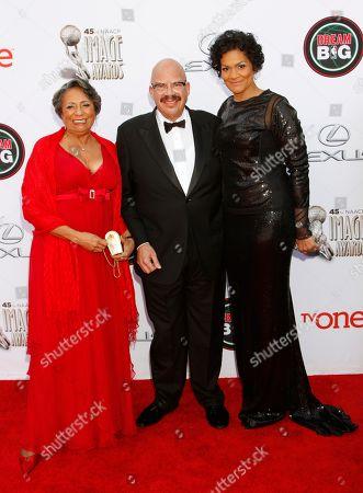 Cathy Hughes and from left, Tom Joyner and Ayiko Broyard arrive at the 45th NAACP Image Awards at the Pasadena Civic Auditorium, in Pasadena, Calif