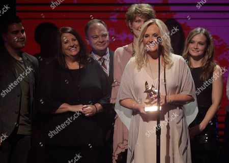 Karen Peck accepts the award for Southern Gospel Artist of the Year at the 47th Annual GMA Dove Awards at Lipscomb University, in Nashville, Tenn