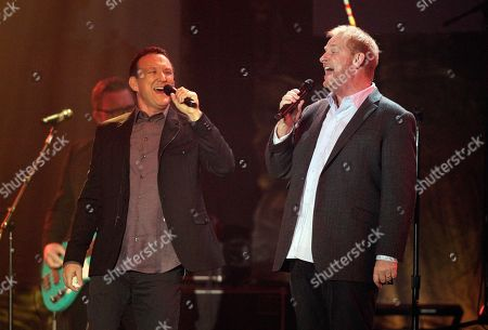 Dan Dean, right, and Randy Phillips of Phillips, Craig and Dean perform at 47th Annual GMA Dove Awards at Lipscomb University, in Nashville, Tenn
