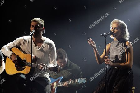 Joel Houston, left, and Taya Smith of Hillsong United perform at the 47th Annual GMA Dove Awards at Lipscomb University, in Nashville, Tenn