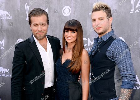 Tom Gossin and from left, Rachel Reinert and Mike Gossin, of the musical group Gloriana, arrive at the 49th annual Academy of Country Music Awards at the MGM Grand Garden Arena, in Las Vegas