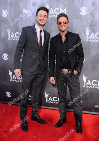 Eric Gunderson, left, and Stephen Barker Liles, of the musical group Love and Theft, arrive at the 49th annual Academy of Country Music Awards at the MGM Grand Garden Arena, in Las Vegas