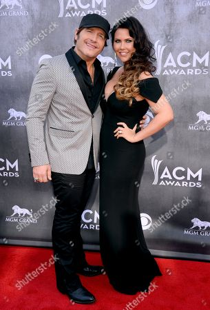 Jerrod Niemann, left, and Morgan Petek arrive at the 49th annual Academy of Country Music Awards at the MGM Grand Garden Arena, in Las Vegas