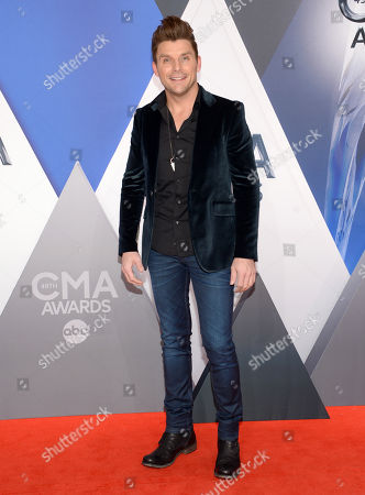 Stock Image of Robby Johnson arrives at the 49th annual CMA Awards at the Bridgestone Arena, in Nashville, Tenn