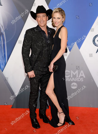 Stock Photo of Clay Walker, left, and Jessica Walker arrive at the 49th annual CMA Awards at the Bridgestone Arena, in Nashville, Tenn